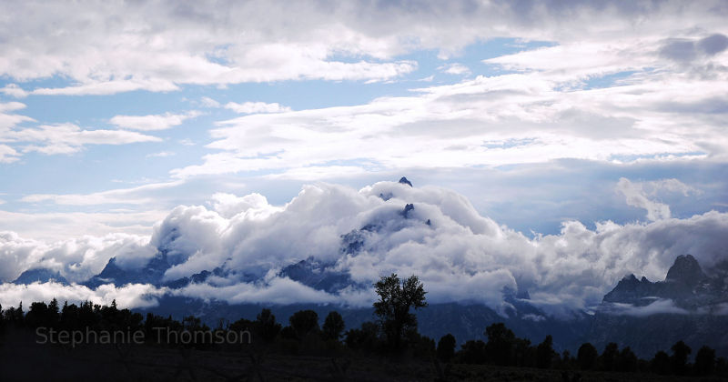 Clouds surround the Grand Tetons