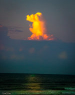 A cloud pillar rises above the Gulf