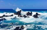 Blue water, and waves crashing over rocks in Maui, Hawaii