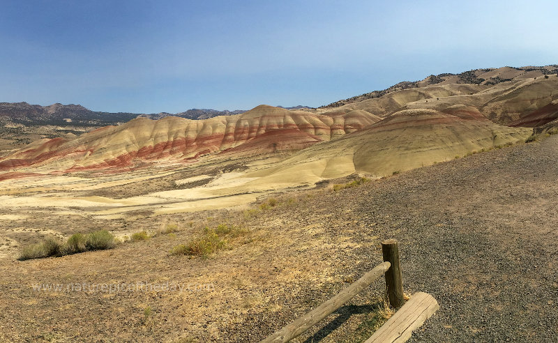 A hill with layers of different colored sediment.