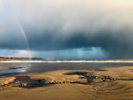Rainbow on the beach in South Wales, UK